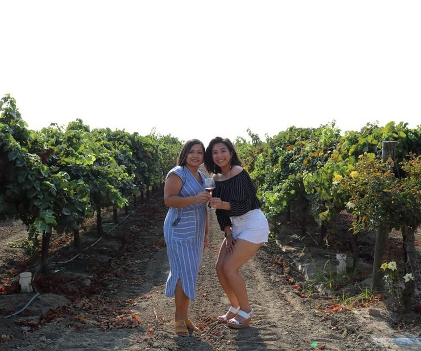 Anne and Ambriss in the vineyard
