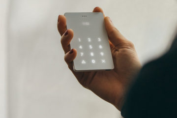 Picture of a hand holding the light phone